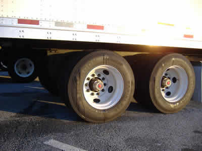 Picture of the rear wheels on trailer of an 18 wheeler